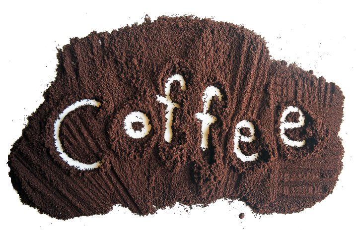 "The word ""coffee"" spelled in spilled coffee grounds."