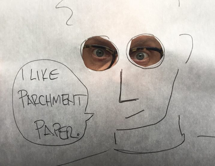 A cartoon Alton Brown drawn on parchment paper.