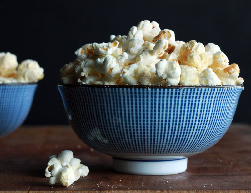 Triple cheese popcorn in a blue bowl