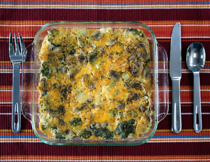cheddar and broccoli casserole in a glass casserole dish