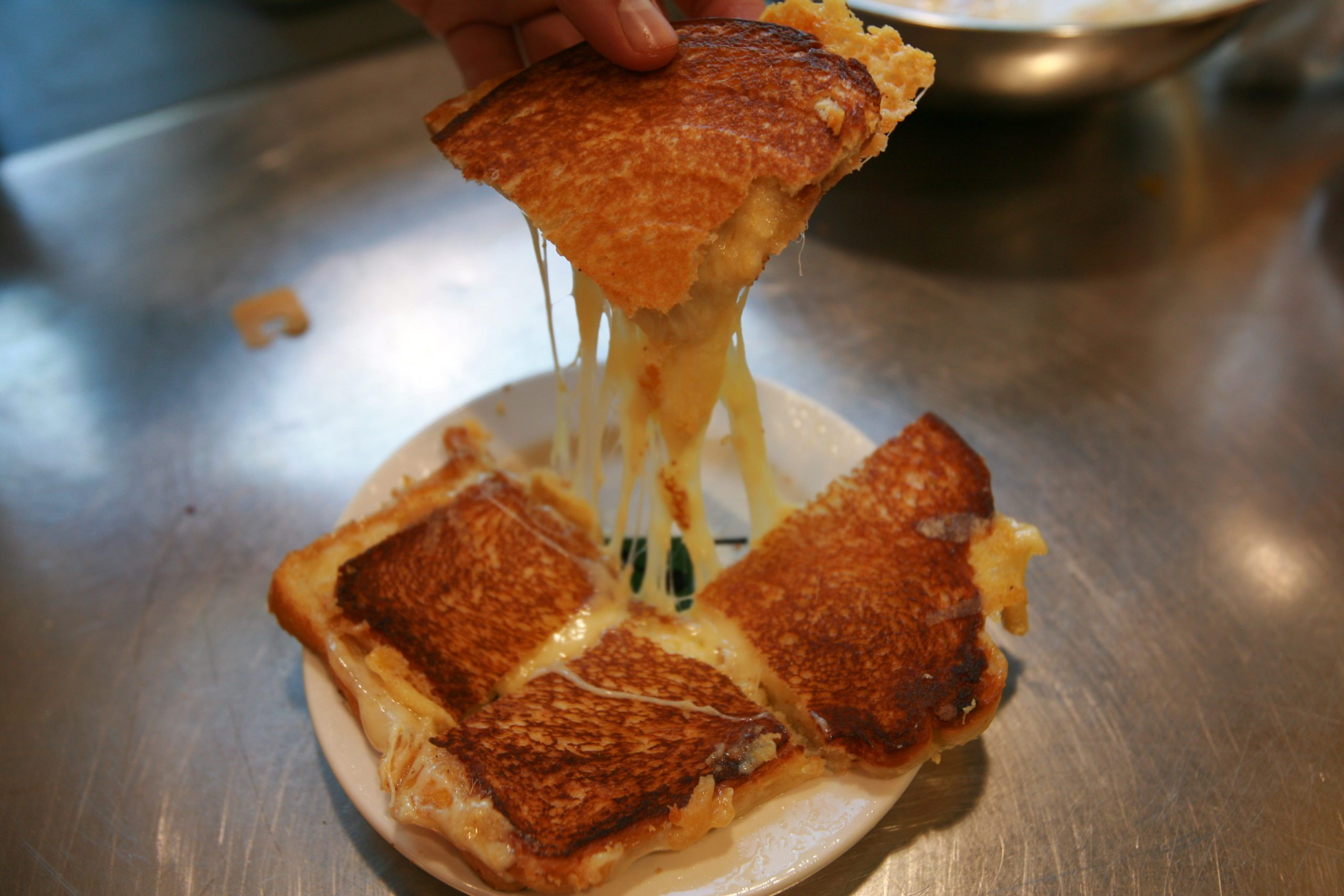 Perfect grilled cheese cheese pull on the set of Alton Brown's Good Eats.