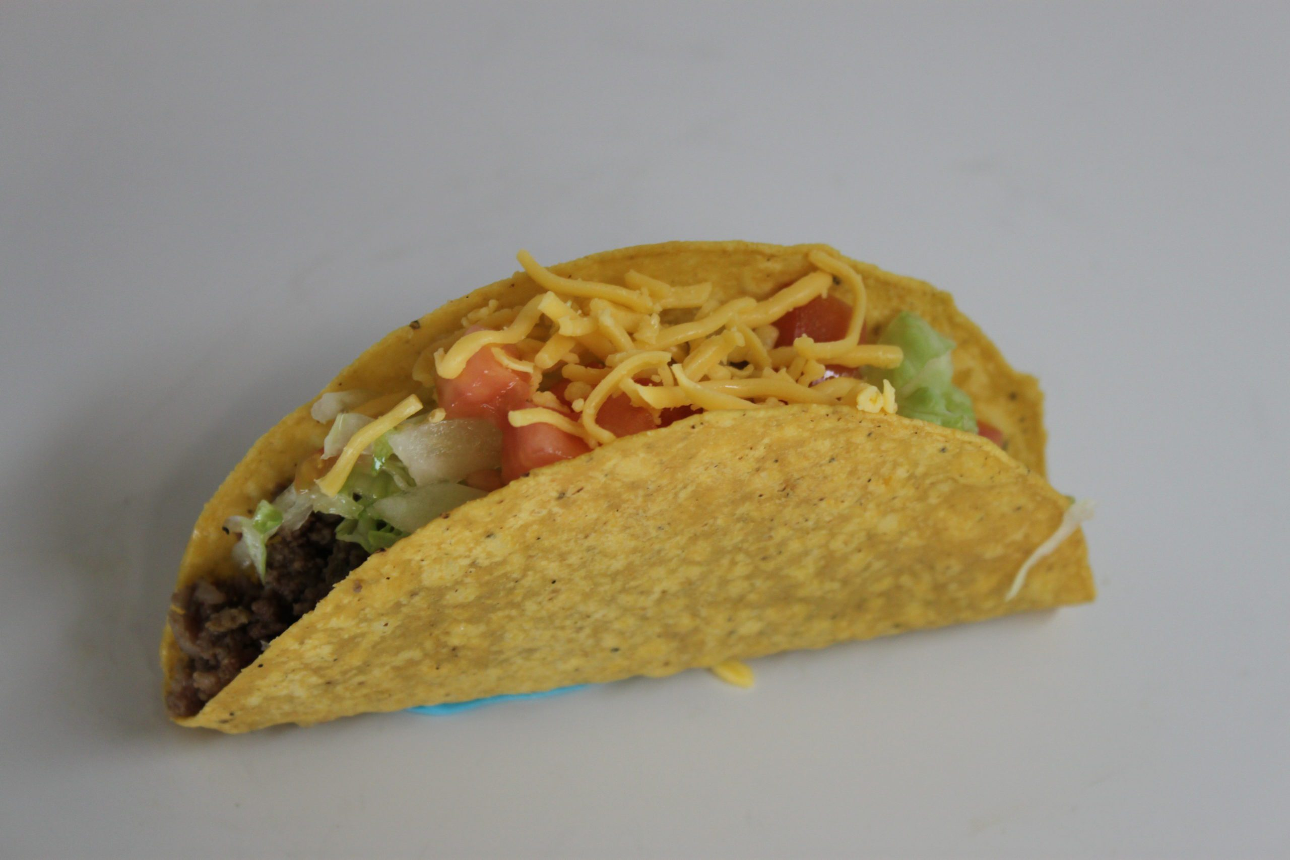 All American beef taco in a corn tortilla shell