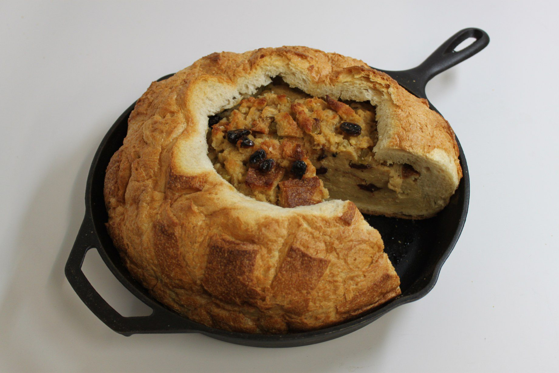 Spiced bread pudding in a cast-iron skillet on the set of Good Eats.