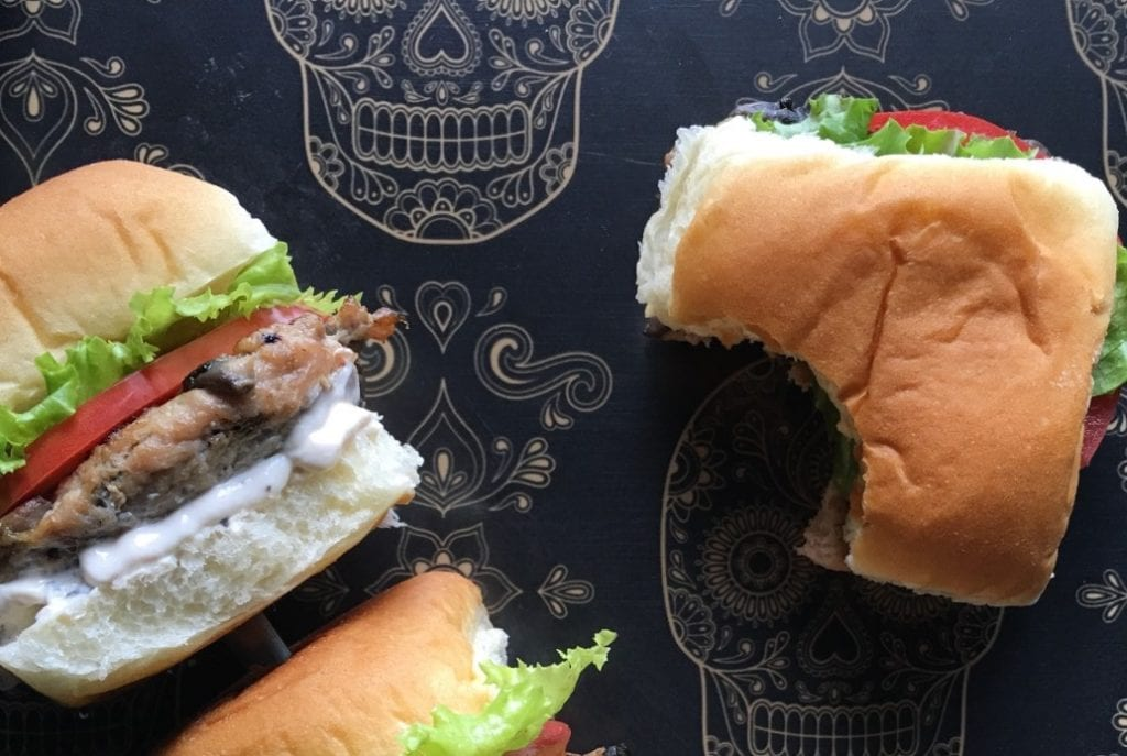 Turkey sliders on skull-patterned tablecloth.