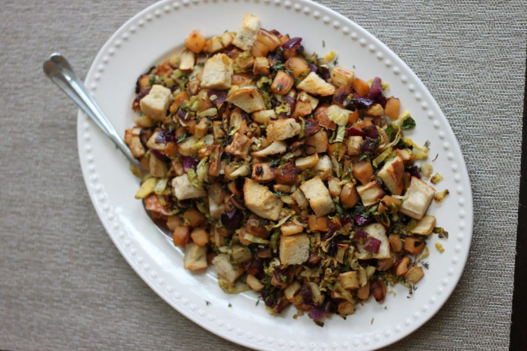 Root vegetable panzanella on a large white serving platter