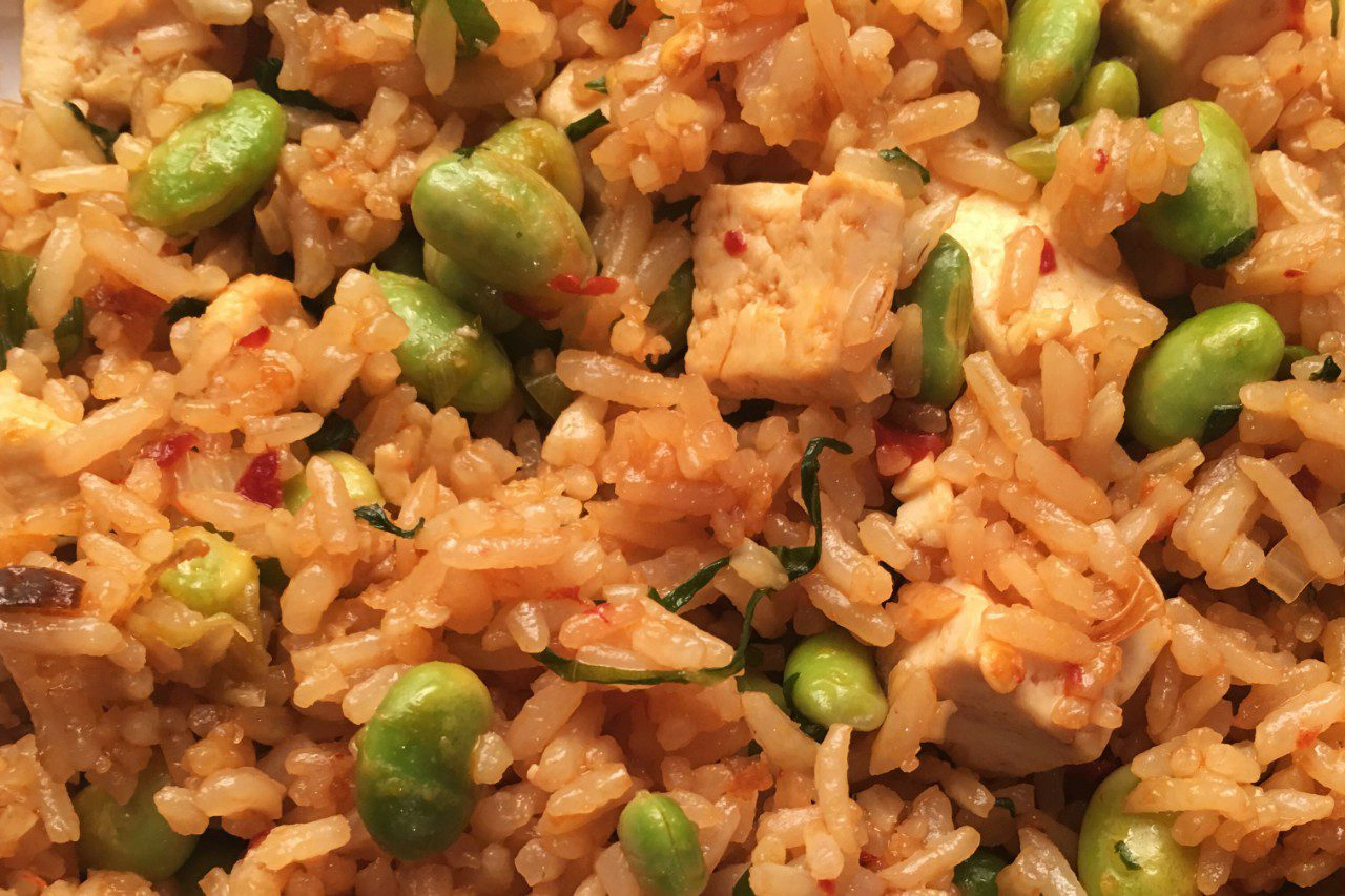 Tofu fried rice with edamame and scallions.
