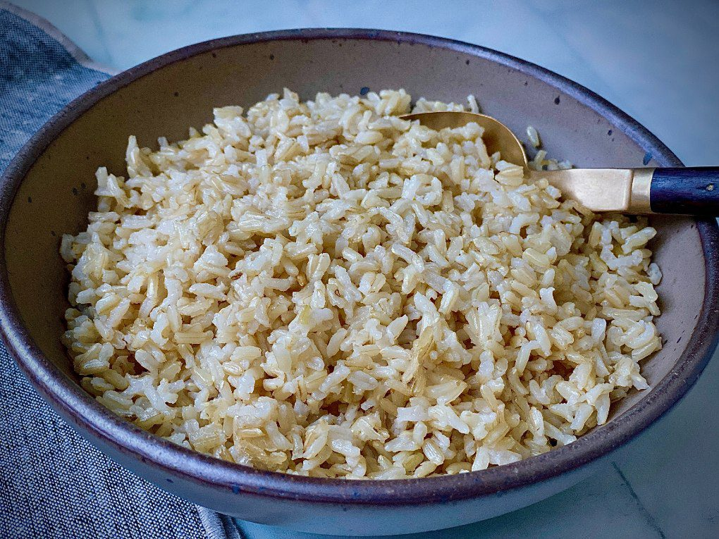 Baked brown rice in a bowl.