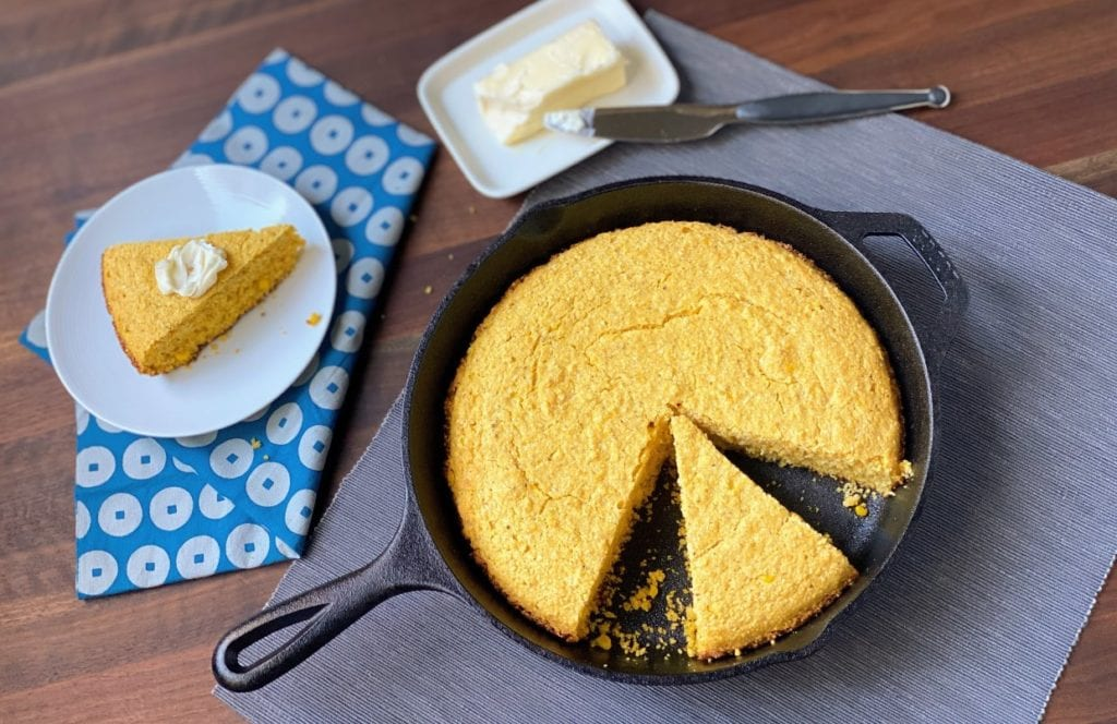 Creamed corn cornbread in a cast iron skillet.