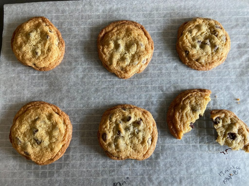 The Thin Chocolate Chip Cookie on a parchment paper-lined wire rack