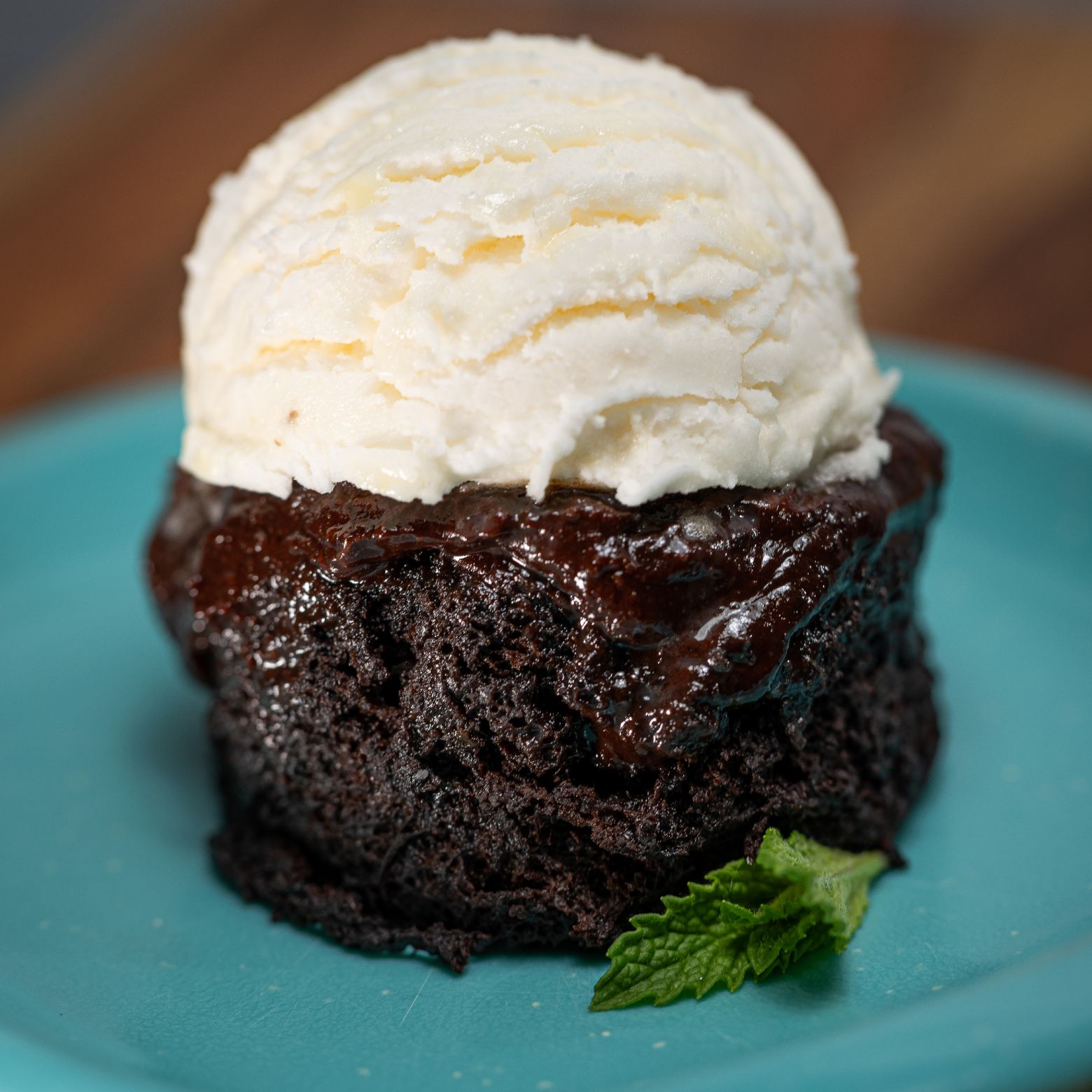 Midnight mug cake for 2 topped with a scoop of vanilla ice cream.