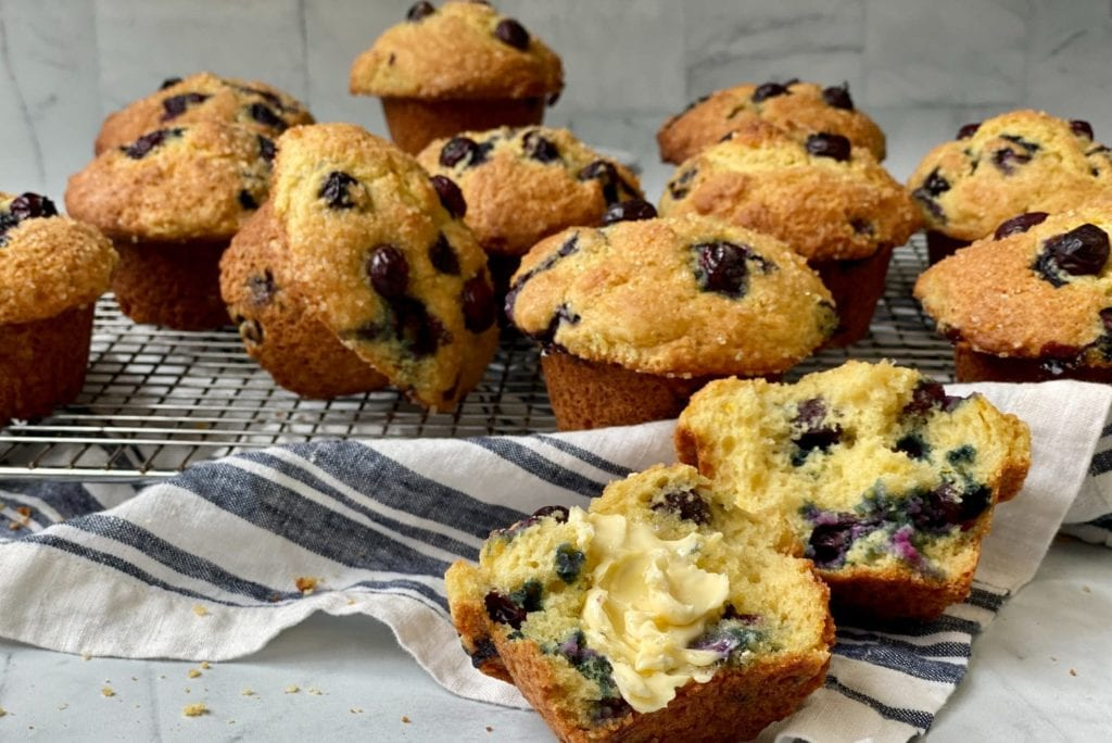 Over the Top Blueberry Muffins on a wire cooling rack.