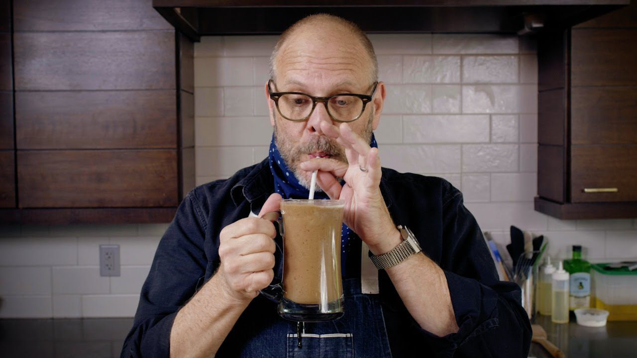 Alton Brown drinking a chocolate date shake