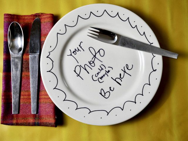 "A white plate with the text ""your photo could be here"" written in Alton Brown's handwriting."