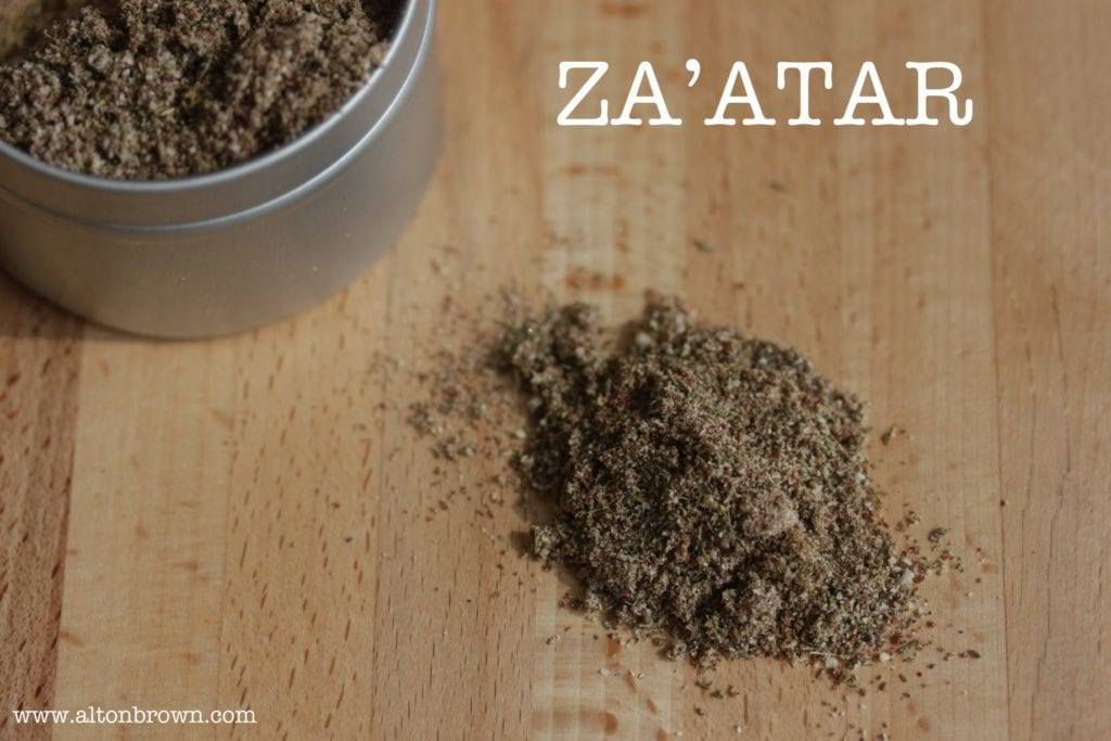 Za'atar on a butcher block cutting board on the set of Alton Brown's Good Eats.