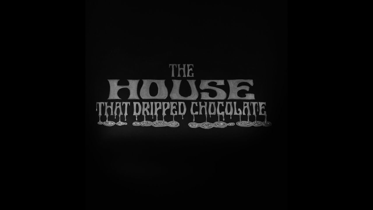 The House That Dripped Chocolate logo written in chalk on the set of Good Eats: The Return season 2.