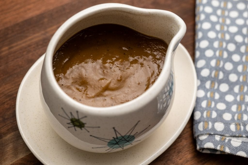Make-ahead Thanksgiving gravy in Alton Brown's vintage china gravy boat.