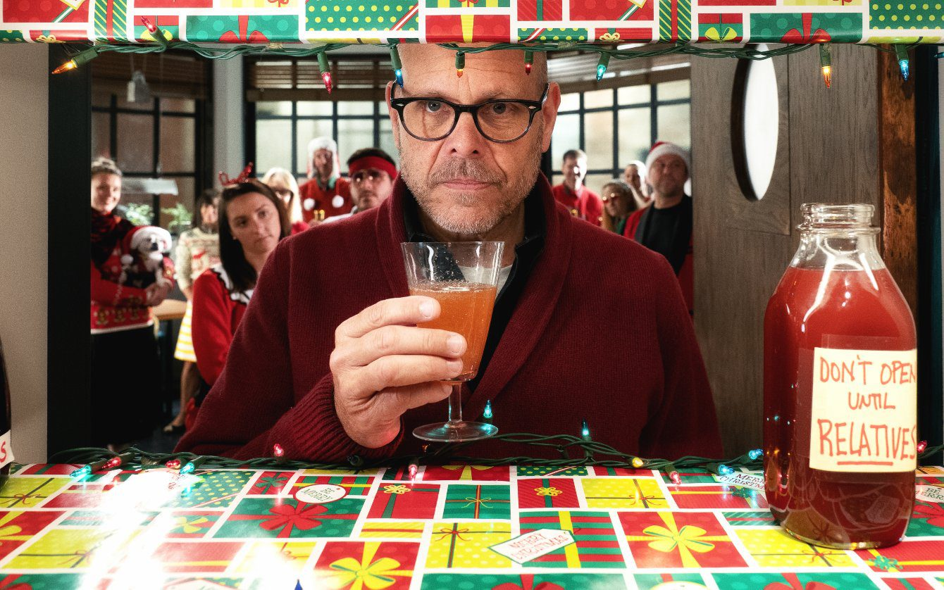 Alton Brown sips a cranberry apple shrub on the set of Good Eats: The Return.